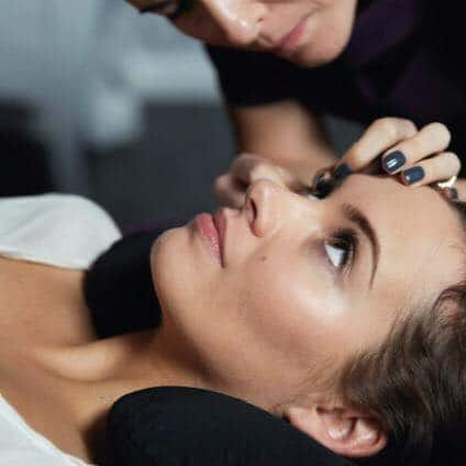 Nouveau Lashes LVL Lash Lift now at The Spa Therapy Room. Woman having LVL lash lift by beauty therapist